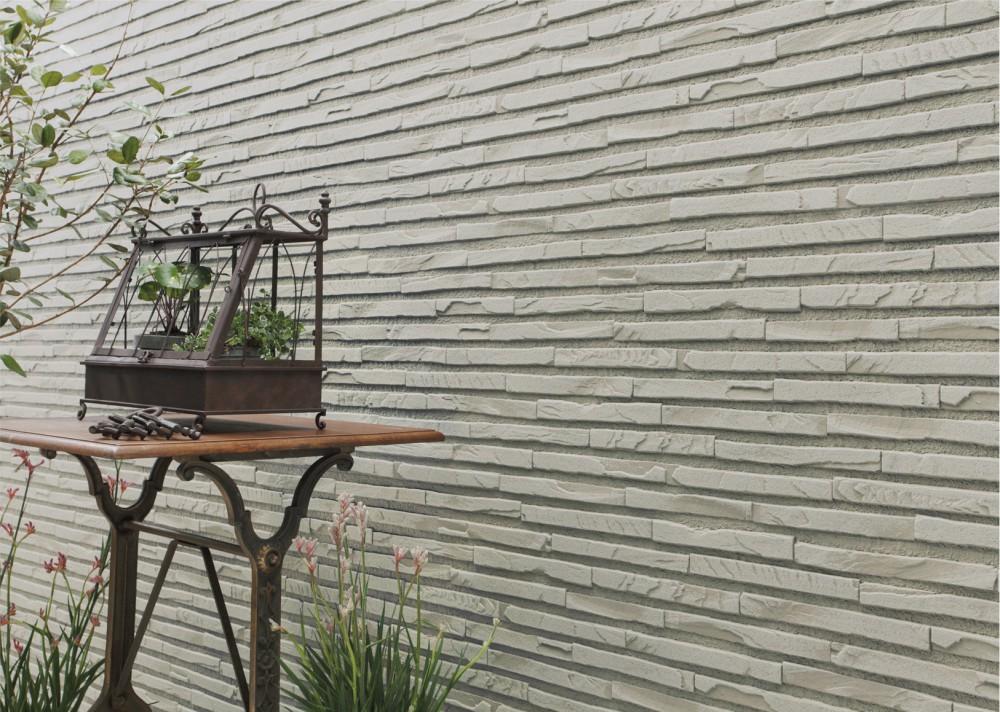 Фасадные панели KMEW под камень
